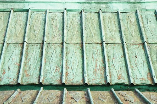 old and dirty copper roof with patina