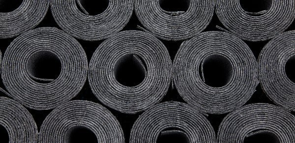 black rolls of rubber roofing membrane