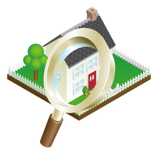 magnifying glass over roof of house