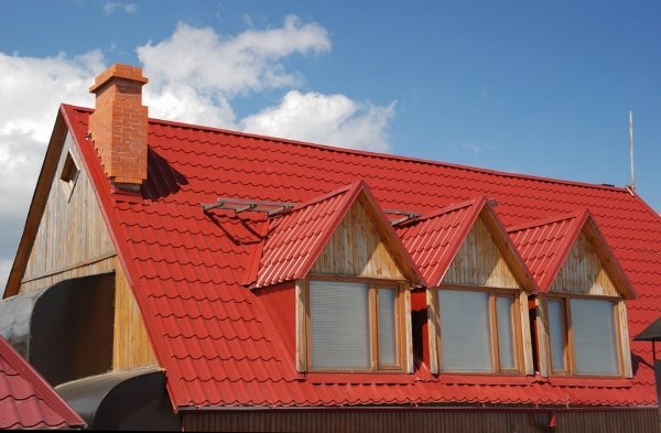 red metal roof with two windows