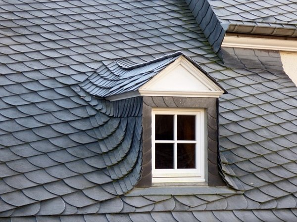 grey slate roof on house with square window