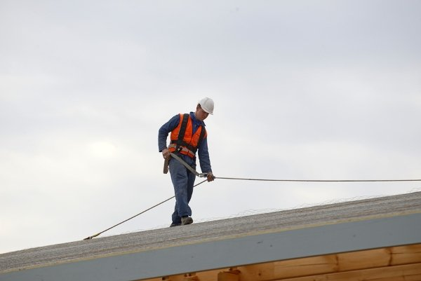 worker on flat roof house design