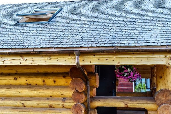 blue colored wood tiles on shed roof of wooden house