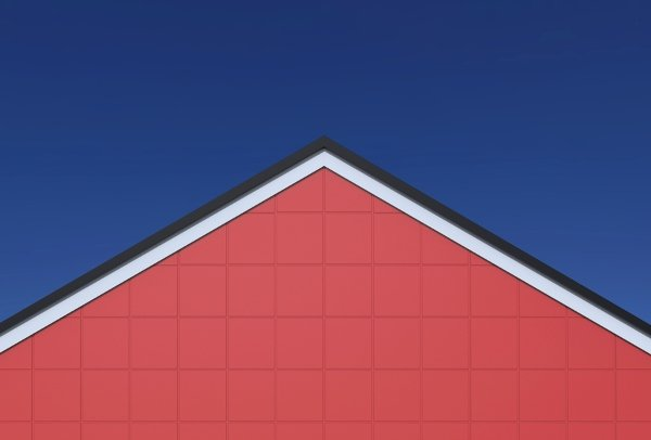 gable roof of red house against blue background