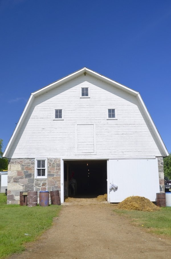 gambrel roof of barn house in farm land
