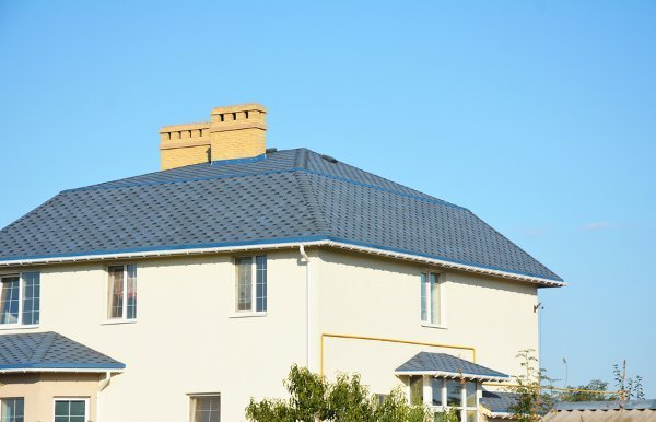 blue green roof with two chimneys