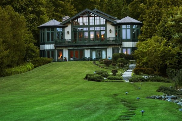 big house with combination roof and glass windows