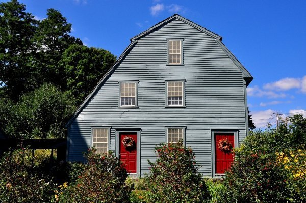 barn style roof with greenish walls and red windows