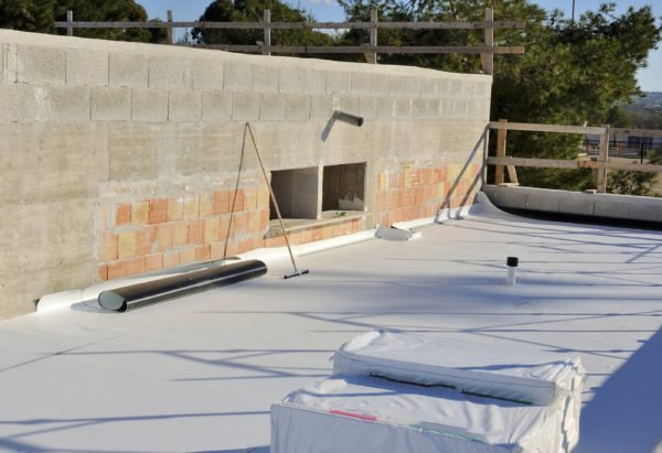 Construction site with waterproofing material