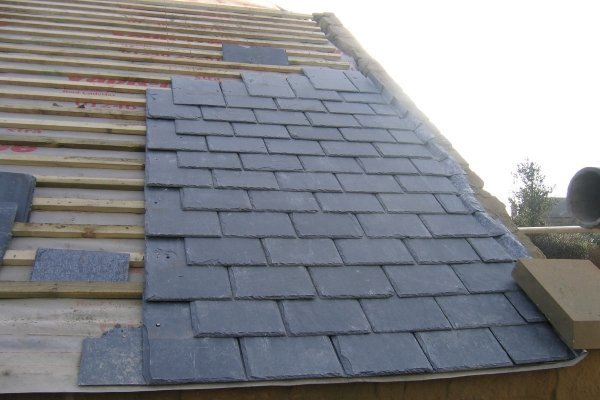 slate tile roof undergoing sheath replacement